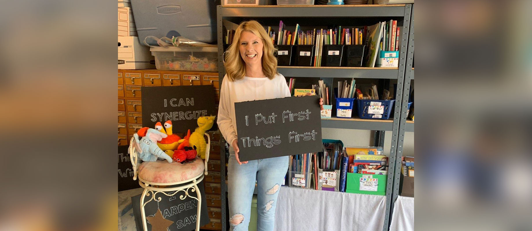 Simpson College alumnus Amy Rowe '12 poses in her garage