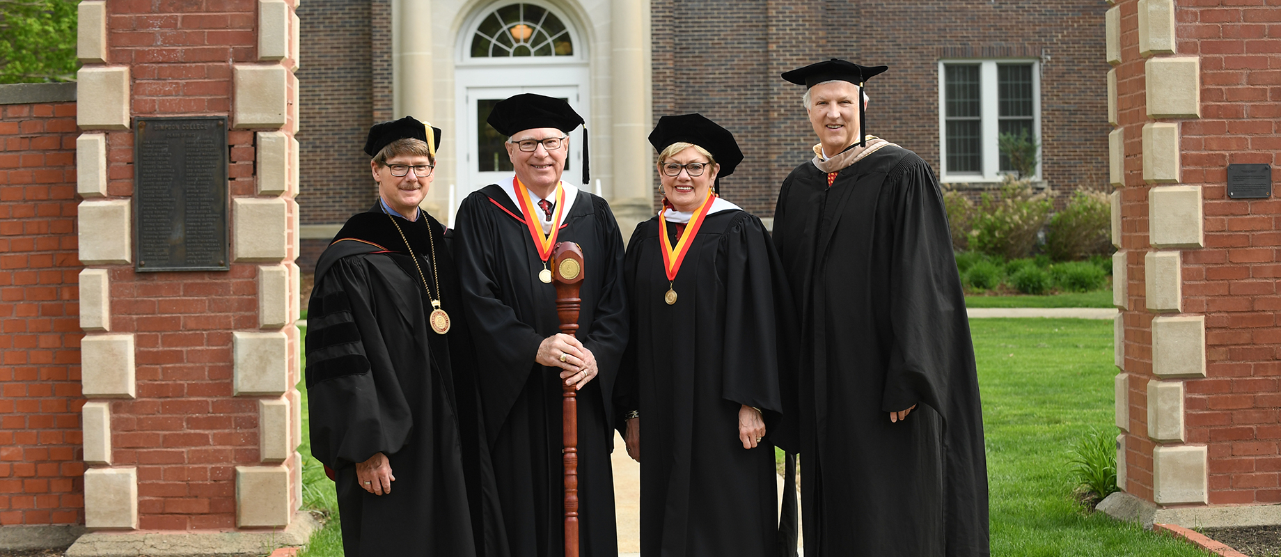 President Jay Simmons (left) poses with Honorary Grand Marshals Chuck '69 and Linda '69 Brice and Board of Trustees Chariman, Terrance Lillis '77.
