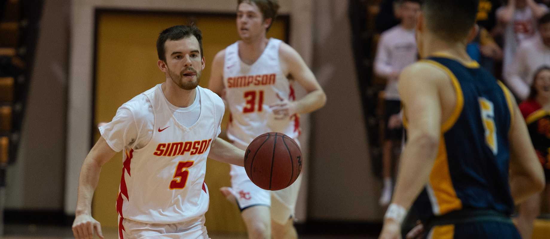 Nick Janssen as a member of the Simpson College basketball team.