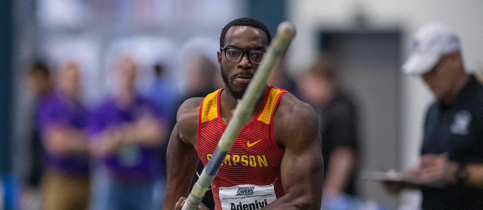 Simpson College's Sam Adeniyi competes in the pole vault