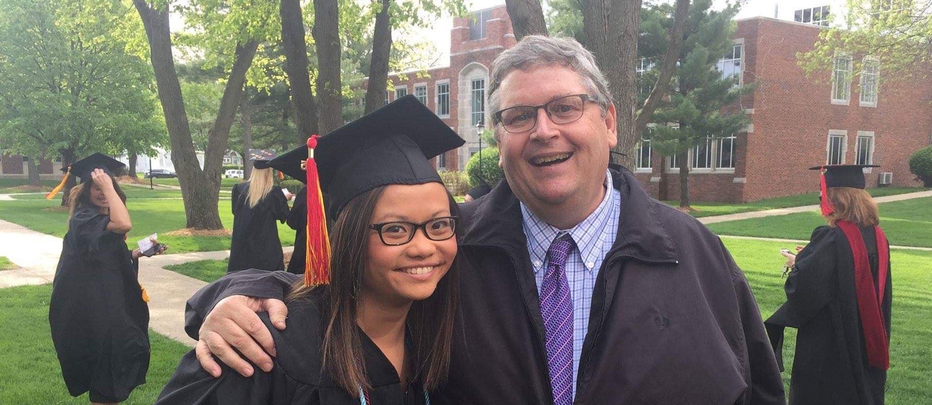 Ken Fuson poses with Steffi Lee '15 following commencement.